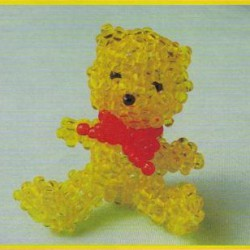 желтый медведь с бантом из бисера