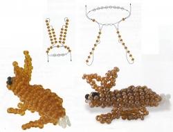 Два варианта плетения маленьких зайчиков.  Милые сувенирчики или брелки.  Схемы и фото готовых изделий из бисера.