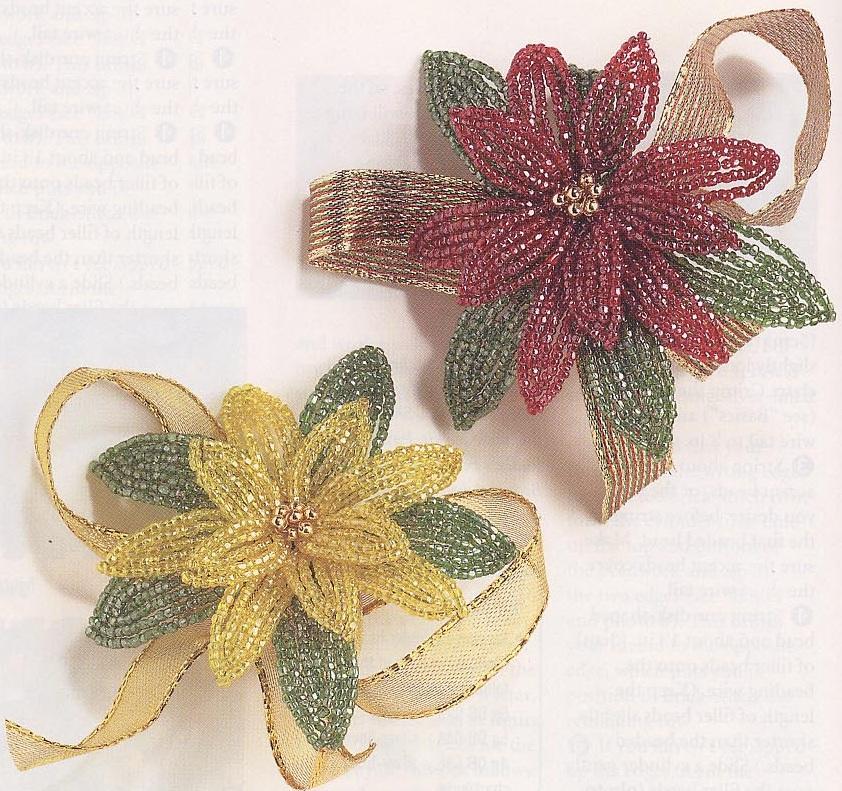 ...несколько золотых бусин - лента - проволока Ход работы:Красивые цветки пуансетии, сплетенные из бисера.
